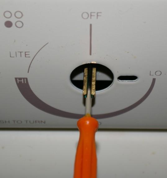 Adjusting the simmer flame